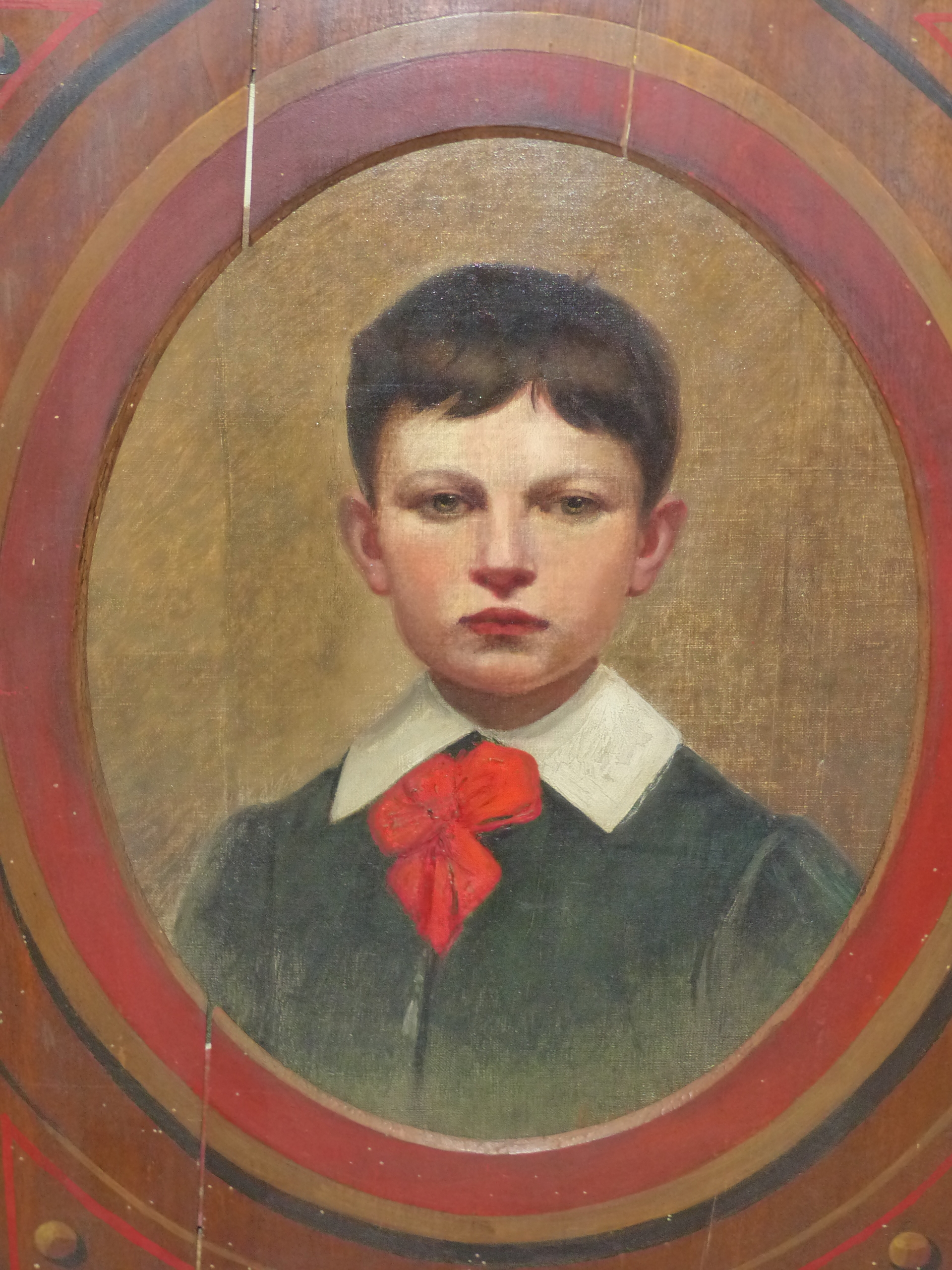 19th CENTURY CONTINENTAL SCHOOL FEIGNED OVAL PORTRAIT OF A BOY. OIL ON CANVAS DECORATIVE PAINTED