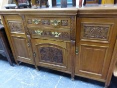 AN WALNUT LATE VICTORIAN BREAKFRONT SIDEBOARD WITH CARVED DOORS AND DRAWERS. W 151 x D 51 x H 95cms.