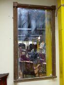 A 19TH CNTURY RECTANGULAR MIRROR IN A GILT FRAME. 137 x 79cms.