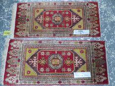 TWO SIMILAR ANTIQUE TURKISH MATS LARGEST 105 x 44 cm, 96 x 44cm (2)