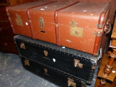 TWO VICTORIAN BLACK TRUNKS AND ANOTHER COVERED IN BROWN CANVAS