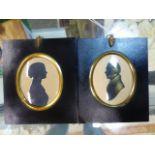 TWO OVAL SILHOUETTESOF A LADY AND OF A GENTLEMAN, THE LATTER WITH GILT DETAILING AND FAINT
