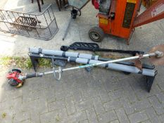 TWO SETS OF ROOF BARS AND A PETROL STRIMMER