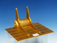 A GILT BRASS ATMOS CLOCK WALL BRACKET, THE SUPPORTING PLATE. 21.5 x 16.5cms.