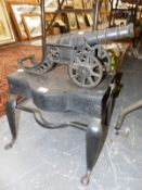 A GEORGIAN IRON FOOTMAN (MODEL CANNON TO BE OFFERED IN A FUTURE SALE).