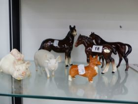 TWO BESWICK PIGS, A BESWICK FOAL, A CORGI AND TWO FURTHER HORSE FIGURES.