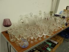 AN EXTENSIVE COLLECTION OF CUT GLASSWARES, TO INCLUDE DECANTERS, BOWLS, VASES ETC.