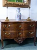 A 18th C. FRENCH WALNUT CHEST THE TWO ARBALETTE FRONTED DRAWERS ABOVE CENTRAL SHELL CARVED ON THE A