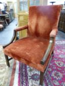 AN ANTIQUE 19TH CENTURY MAHOGANY GAINSBOROUGH CHAIR UPHOLSTERED IN RUST COLOURED VELVET
