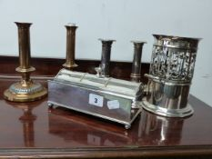 AN ART NOUVEAU BOTTLE STAND, 2 PAIRS OF SILVER PLATED CANDLESTICK AND A PLATED DESK STAND.