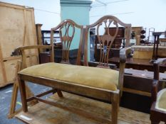 A MAHOGANY CHIPPENDALE STYLE TWIN BACKED CHAIR, THE HANDLES OF THE ARMS FOLIATE CARVED, THE DROP