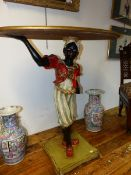 A CARVED GILT OVAL TABLE SUPPORTED BY A HAND AND THE TURBANNED HEAD OF A BLACKAMOOR FIGURE WEARING