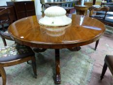 A MAHOAGANY VICTORIAN CIRCULAR BREAKFAST TABLE SUPPORTED ON TURNED COLUMN AND TRIPOD ENDING IN LEAF