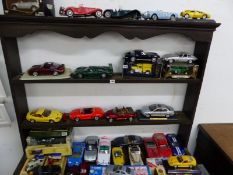 A SMALL COLLECTION OF LARGE DIE CAST AND OTHER VEHICLES TO INCLUDE CORGI, BURAGO, MAISTO AND OTHERS.