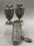 A PAIR OF WHITE METAL ASSESSED AS SILVER PIERCED AND FLARED JARS, TOGETHER WITH A CONTINENTAL SILVER
