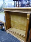 A PINE OPEN BOOKCASE WITH TWO SHELVES ADJUSTABLE BELOW THE DENTIL CORNICE. W 108 x D 31 x H 118cms.