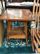 AN ARTS AND CRAFTS OAK TABLE, THE SQUARE TOP GEOMETRICALLY INLAID, THE SQUARE LEGS FLARING AWAY FROM