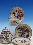 A CHINESE IMARI LOBED TEA POT AND COVER PAINTED WITH FLOWERS TOGETHER WITH A TEA BOWL AND THREE