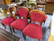 A MATCHED SET OF SIX VICTORIAN MAHOGANY BALLOON BACKED CHAIRS UPHOLSTERED IN RED