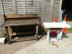 A WORKBENCH AND A SMALL GARDEN TABLE WITH CAST IRON SINGER BASE.