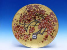A JAPANESE GOLD GROUND DISH PAINTED WITH FLOWERING CHERRY, A TWO CHARACTER MARK (KIZAN?) BY THE