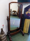 A VICTORIAN MAHOGANY FRAMED FULL LENGTH CHEVAL MIRROR, THE REEDED COLUMNS TOPPED BY CABOCHON ORNAMEN