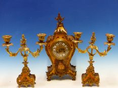 A FRENCH CLOCK GARNITURE, THE BALLOON SHAPED GOLD GROUND CLOCK WITH ENAMELLED NUMERALS SET IN A GILT
