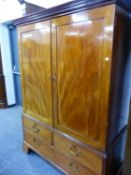 A GEORGE III MAHOGANY SMALL LINEN PRESS CONVERTED AS A WARDROBE. W 130 X D 66 X H 181CMS.