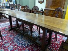 AN ARTS AND CRAFTS STYLE OAK REFECTORY TABLE ON DOUBLE SQUARE PILLAR END SUPPORTS. W 271 X D 62 X