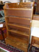 A FRUITWOOD (OLIVE?) WATERFALL BOOK CASE, THE FIVE SHELVES ABOVE A LIDDED COMPARTMENT. W 77 x D 34 x