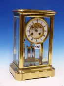 A MANTEL CLOCK IN GLAZED BRASS CASE STRIKING ON A BELL, THE PENDULUM MERCURY COMPENSATED, THE