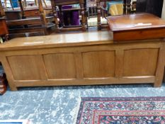 AN ARTS AND CRAFTS OAK COFFER WITH FOUR PANELLED FRONT. W 150 x D 41 x H 48cms.