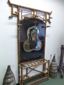 AN ANTIQUE BAMBOO AND BLACK CHINOISERIE LACQUER HALL STAND WITH CENTRAL QUATREFOIL MIRROR. W 140 x