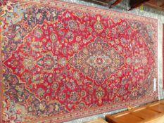 A PERSIAN TABRIZ RUG, 240 X 142cm