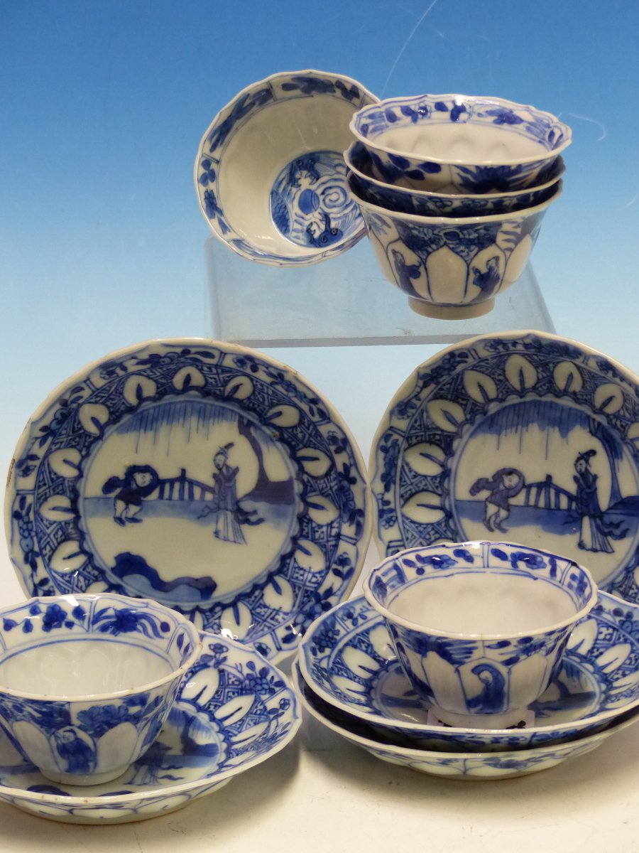 A SET OF SIX CHINESE BLUE AND WHITE TEA BOWLS AND SAUCERS, THE LATTER CENTRALLY PAINTED WITH A