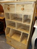 A PINE UNIT WITH SHELVING CENTRAL TO DRAWERS. W 68 x D 38 x H 109cms.