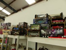 A COLLECTION OF BOXED BURAGO, MAISTO, A CORGI HERITAGE EXAMPLE AND OTHER VEHICLES.