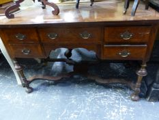 A MAHOGANY VENEERED WRITING TABLE, THE CROSS BANDED RECTANGULAR TOP OVER FIVE DRAWERS AND BALUSTER