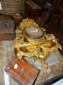 A GILT WOOD FLORAL CLOCK CASE, A ROSEWOOD SARCOPHAGUS TEA CADDY AND FOUR VARIOUS BOXES