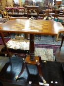 A CROSS BANDED ROSEWOOD CHESS TABLE ON TURNED MAHOGANY COLUMN, ROSEWOOD PLINTH AND MAHOGANY LEGS
