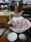 AN ANTIQUE WASH JUG AND BASIN, TWO PARASOLS, AND AN ORIENTAL PAGE TURNER.