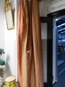 A PAIR OF LINED SILK CURTAINS WITH VERTICAL TERRACOTTA AND PINK STRIPES WITH PELMETS, EACH DROP