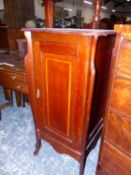 A SATIN WOOD CROSS BANDED MAHOGANY BEDSIDE CUPBOARD, THE DOOR ENCLOSING TWO SHELVES. W 51 x D 51 x H