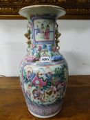 A PAIR OF 19th C. CANTON VASES PAINTED WITH RESERVES OF COURTIERS ON ONE SIDE OF THE BUDDHIST LION H