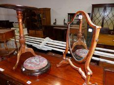 A MAHOGANY SHIELD SHAPED DRESSING TABLE MIRROR, A BEADWORK CIRCULAR FOOT STOOL AND A MAHOGANY TRIPOD