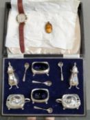 A HALLMARKED SILVER CASED SIX PART CRUET SET COMPLETE WITH FOUR SILVER SPOONS, TOGETHER WITH A