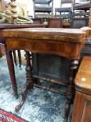 A BURR WALNUT GAMES TABLE, THE SERPENTINE FRONTED TOP SWIVELLING OPEN TO REVEAL CHESS AND BACKGAMMON