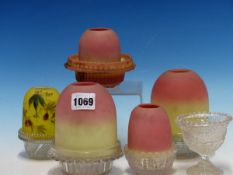 FIVE CLARKES BURMESE GLASS FAIRY LAMP SHADES TO INCLUDE A YELLOW EXAMPLE PAINTED WITH FLOWERING