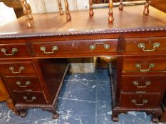 A MAHOGANY PEDESTAL DESK, THE LEATHER INSET TOP ABOVE A CENTRAL DRAWER FLANKED BY FOUR TO EACH
