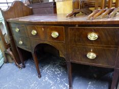 A GEORGIAN BOW FRONTED SIDEBOARD, THE CENTRAL DRAWER FLANKED BY TWO OTHERS AND A CELLARETTE DRAWER,